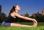 Woman stretching in central park